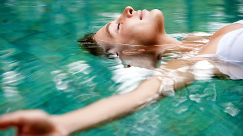 Woman floating in the Keppel Bay in Australia.