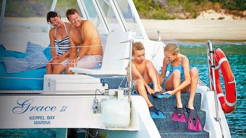 Kids putting on swim gear on the Keppel Bay in Australia.