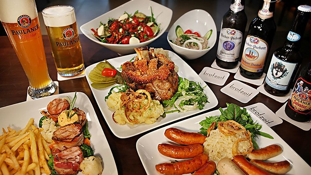 An assortment of food and beer from a bar in Berilin