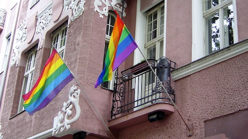 Pride flags outside a building in Berlin