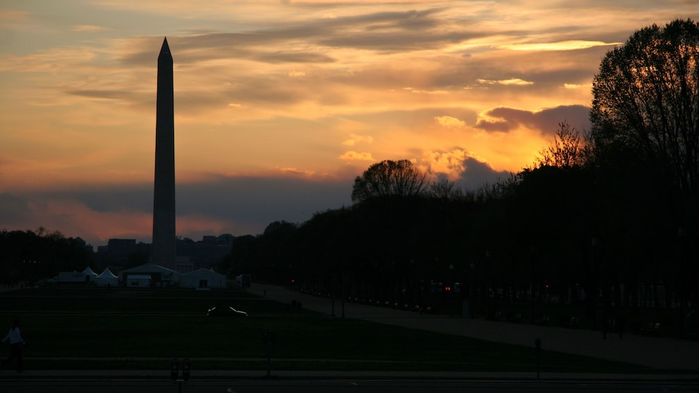 Show item 2 of 5. Sun setting at the Washington Memorial in Washington DC