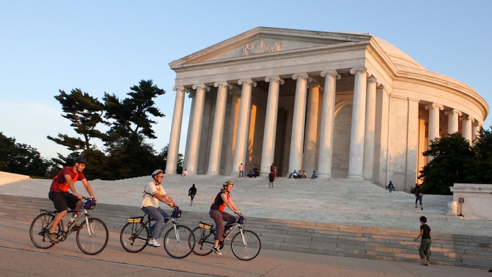 Show item 1 of 5. Bikers riding along the Jefferson Memorial in Washington DC