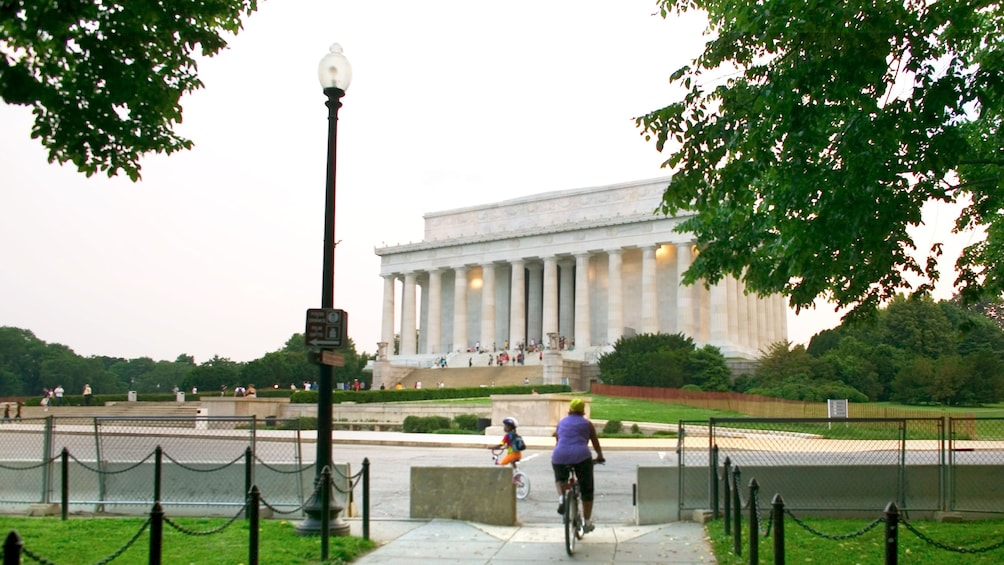 Show item 1 of 3. Biking towards the Lincoln Memorial in Washington DC