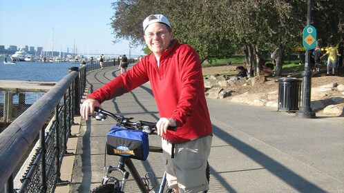 Biking man on bike path near the water in New York City