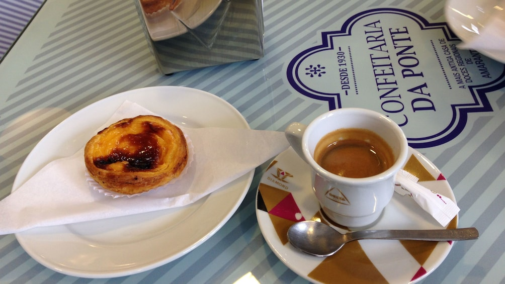 Ver elemento 6 de 6. Pastry and Espresso on dishes at a restaurant
