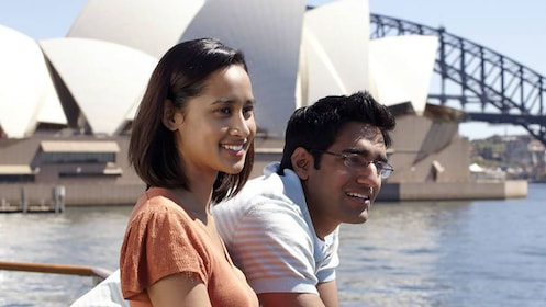 Couple smiling as they are aboard a Sydney Harbour cruise in Australia