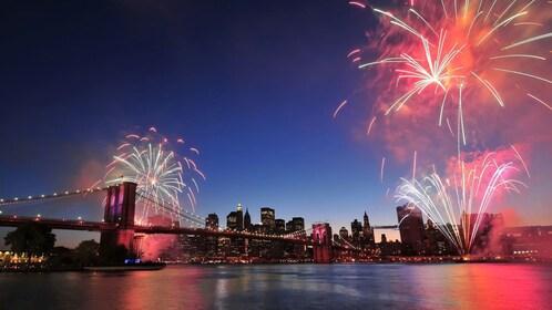 Brooklyn Bridge at night with fireworks in New York