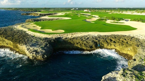 Waves crash on the rocky coastline of a fabulous golf course