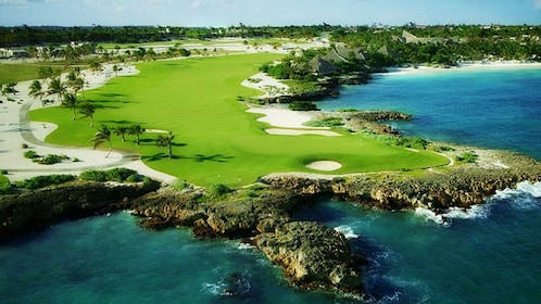 Caribbean golf course featuring perfectly maintained grass fields and palm trees