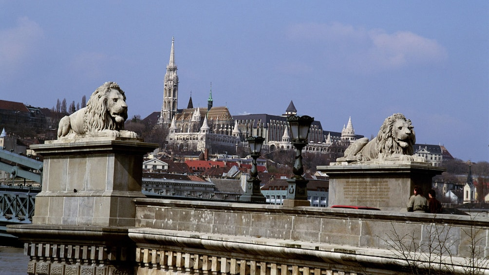 Show item 2 of 10. Lions statues perched atop a bridge in Budapest