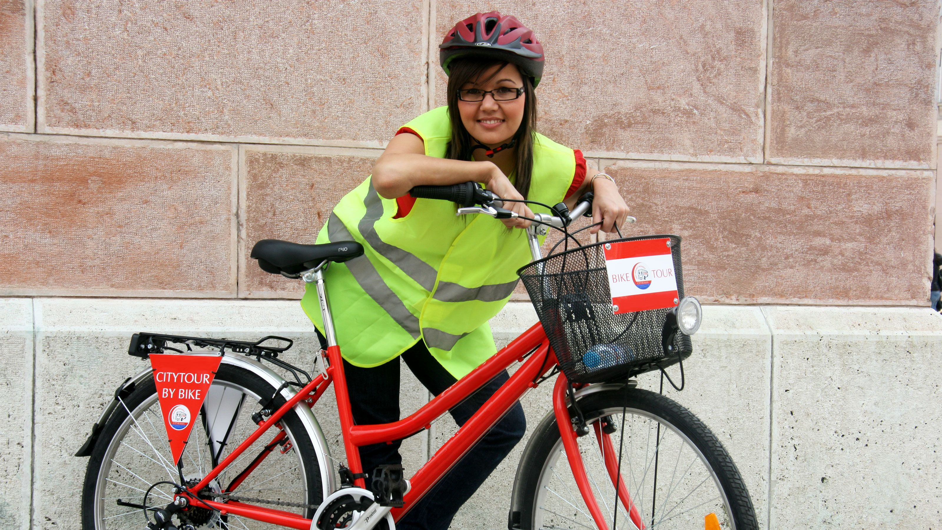 Woman excited to tour Budapest in bicycle