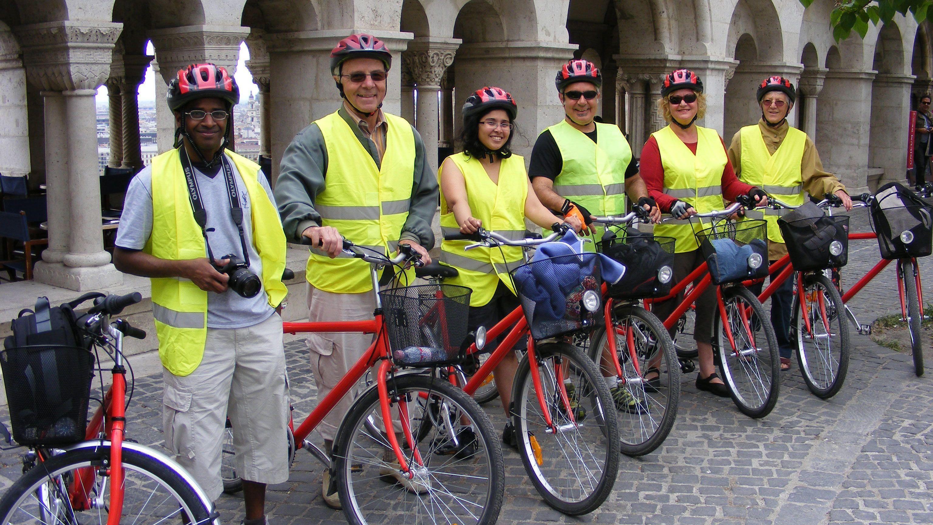 Tourists prepare to tour Budapest on bike
