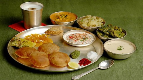 friend Indian bread with assorted dipping sauces at cooking class in Melbourne