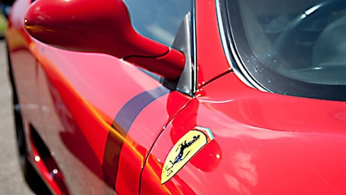 detail shot od logo and side mirror on red Ferrari in Melbourne