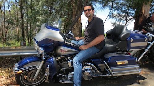 man sitting on Harley Davidson in Blue Mountains