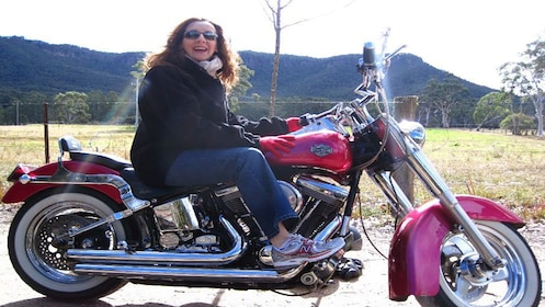 woman sitting on Harley Davidson in Blue Mountains