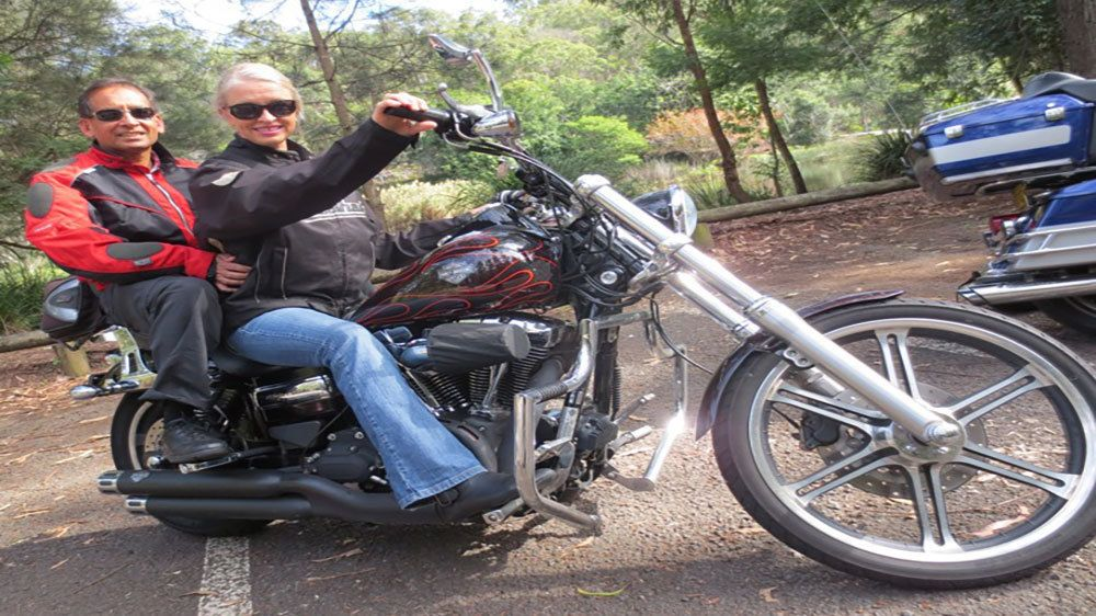 man and woman sitting on Harley Davidson in Blue Mountains
