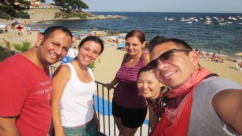 friends take selfy on beach in Barcelona