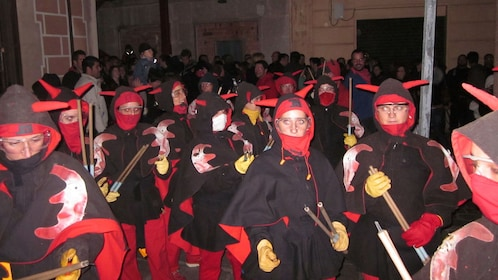 group of people dressed in costume for correfoc celebration in Barcelona