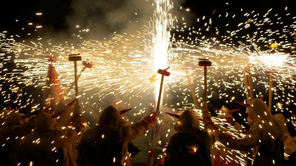 Show item 1 of 5. many people celebrating correfoc fire running in Barcelona