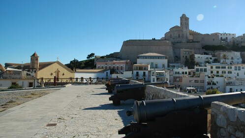 Cannons on top of Ibiza Castles with city in background.