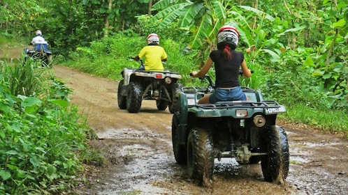 Riding the ATV on the road in Saint Lucia