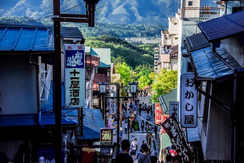 Show item 2 of 7. View down busy Gunma street