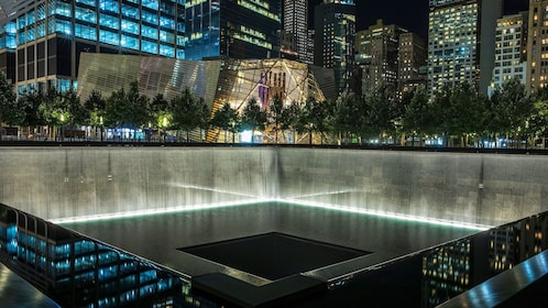 View of the reflection pool memorial at night at the National September 11 Memorial Museum in New York