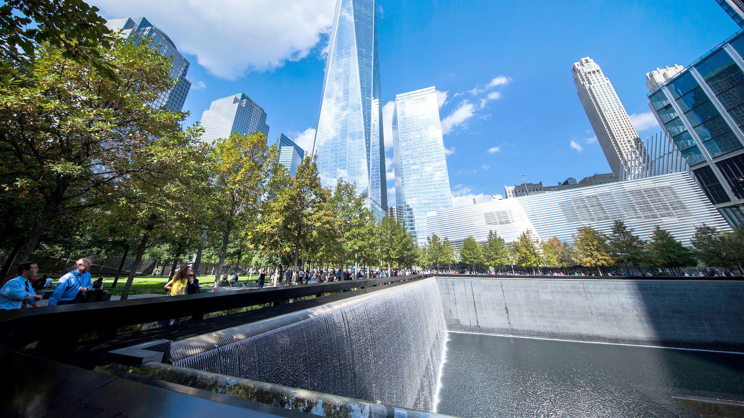View of One World trade center and reflecting pool at the National September 11 Memorial Museum in New York