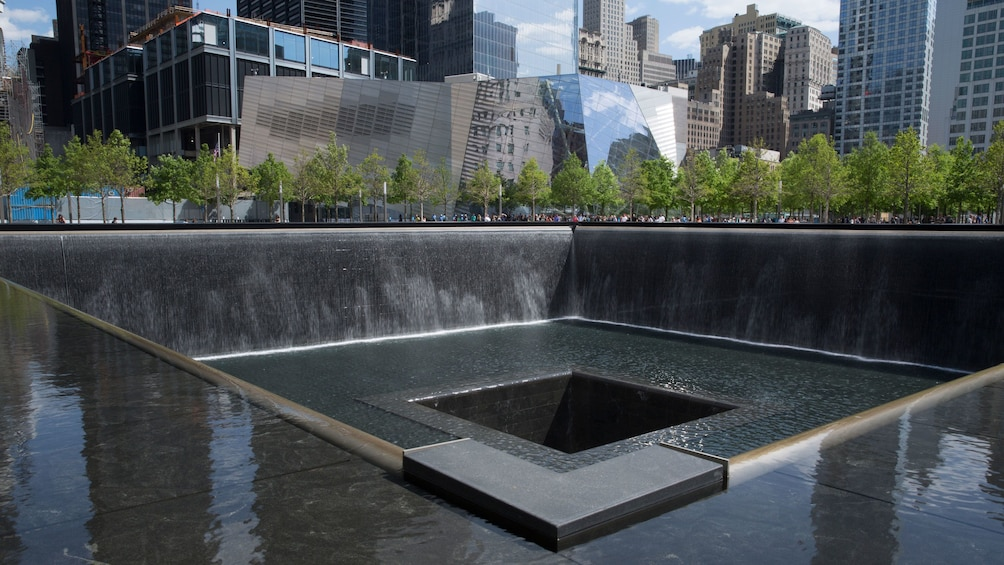 Show item 5 of 10. Fountain at the National September 11 Memorial & Museum in New York