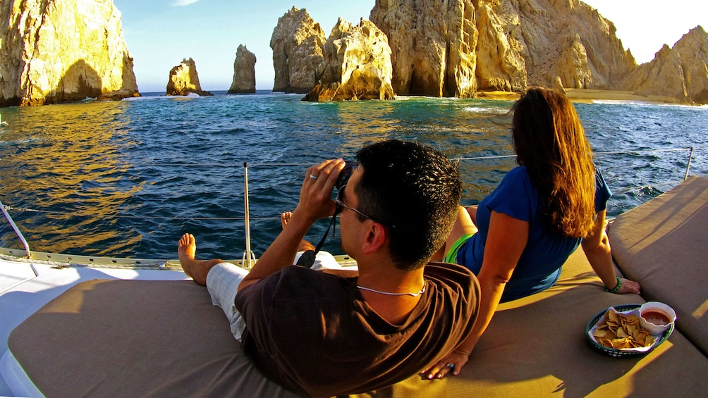 Show item 2 of 10. Photographing the sunset cruise in Los Cabos