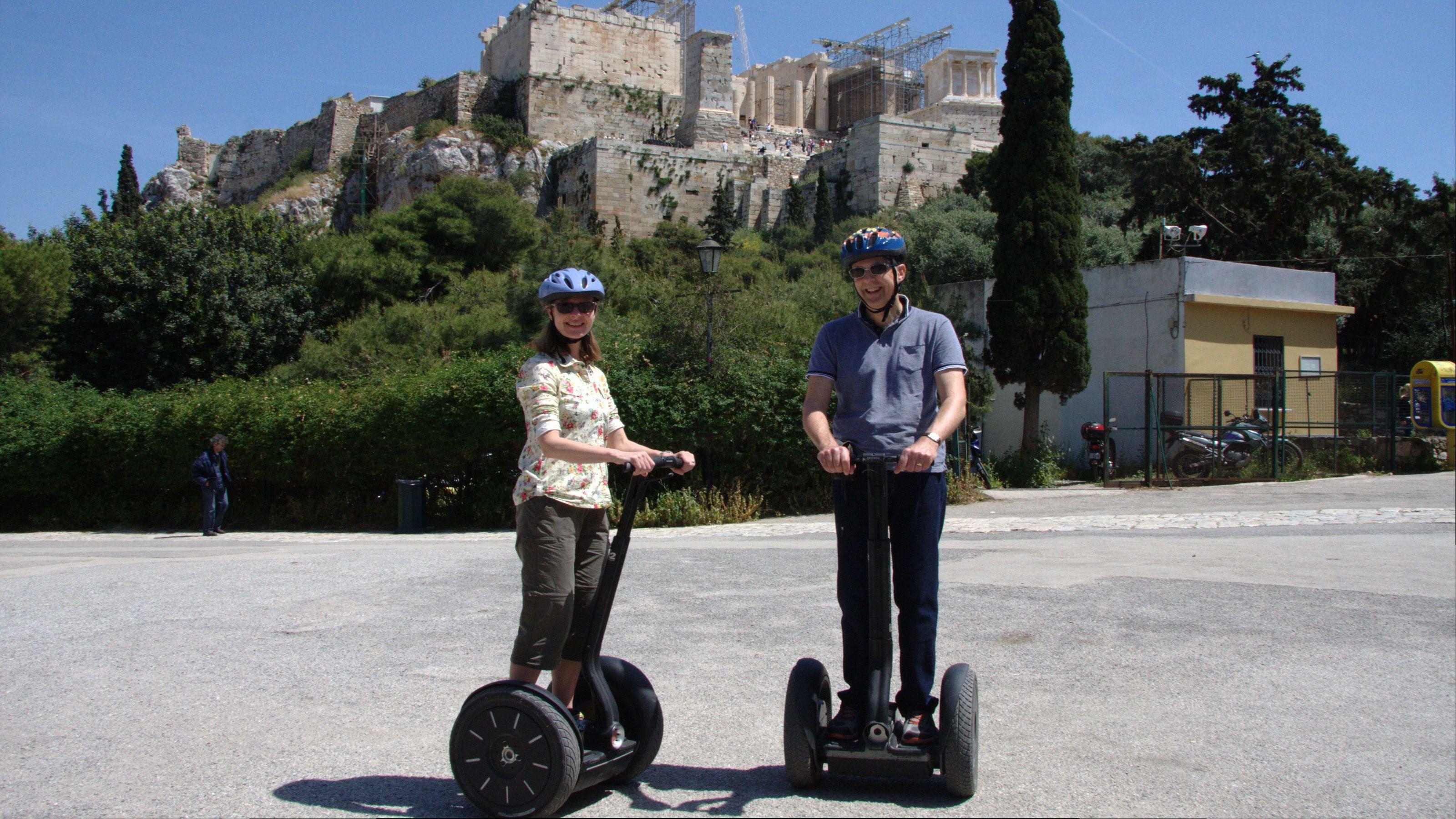 two people ride segways around Dionysou Aeropagitou in Athens