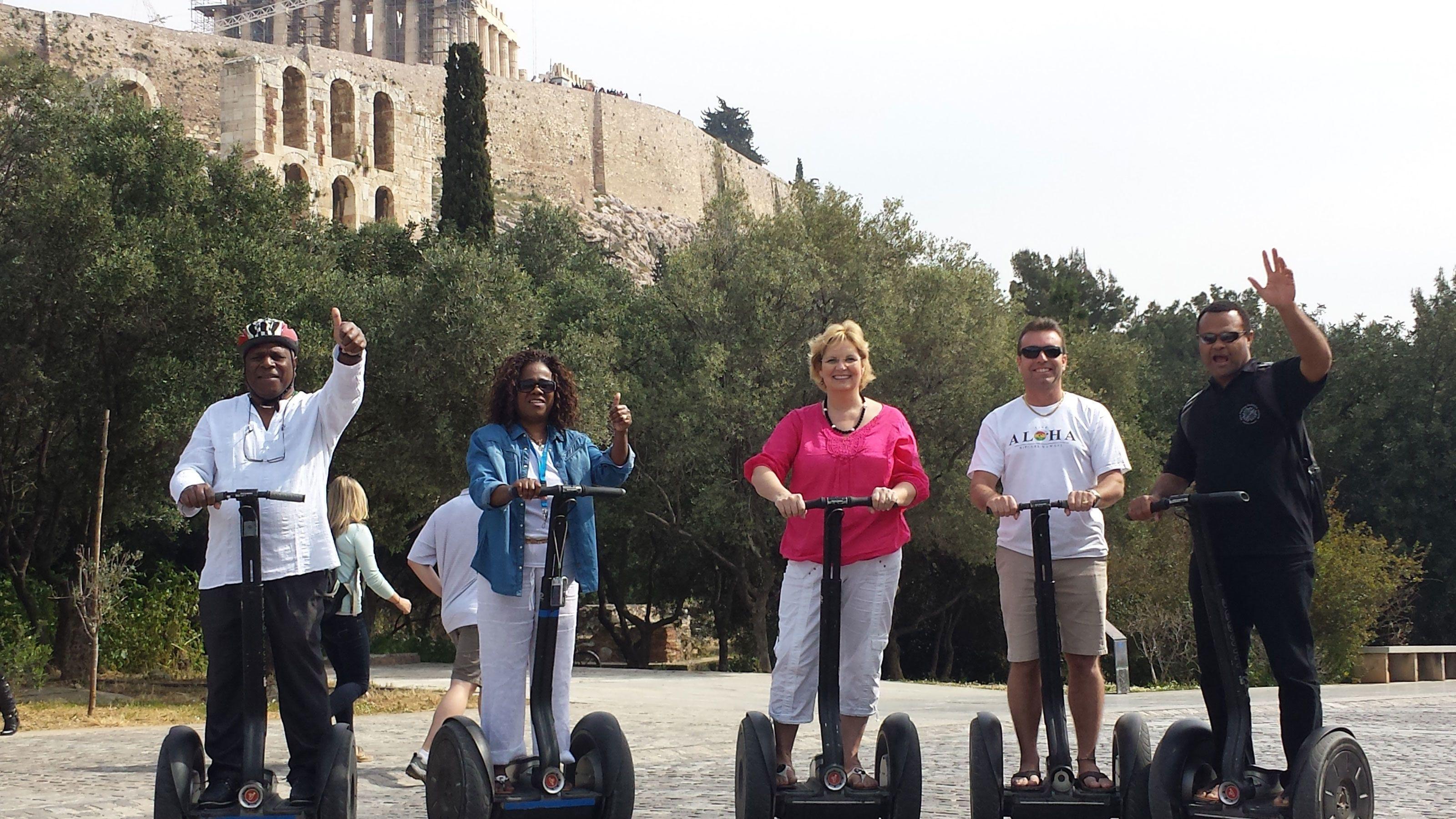 people riding their segways around Dionysou Aeropagitou in Athens
