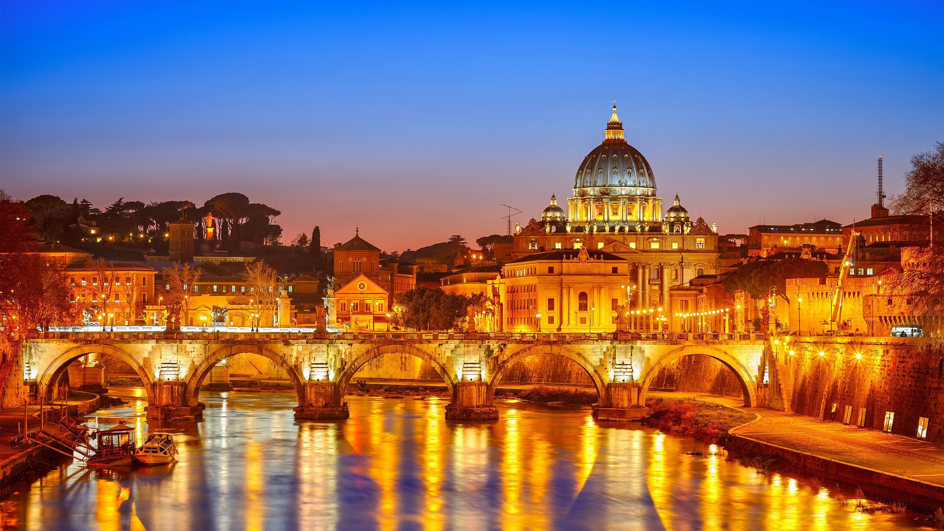 St. Peter's cathedral lit up at night in Rome