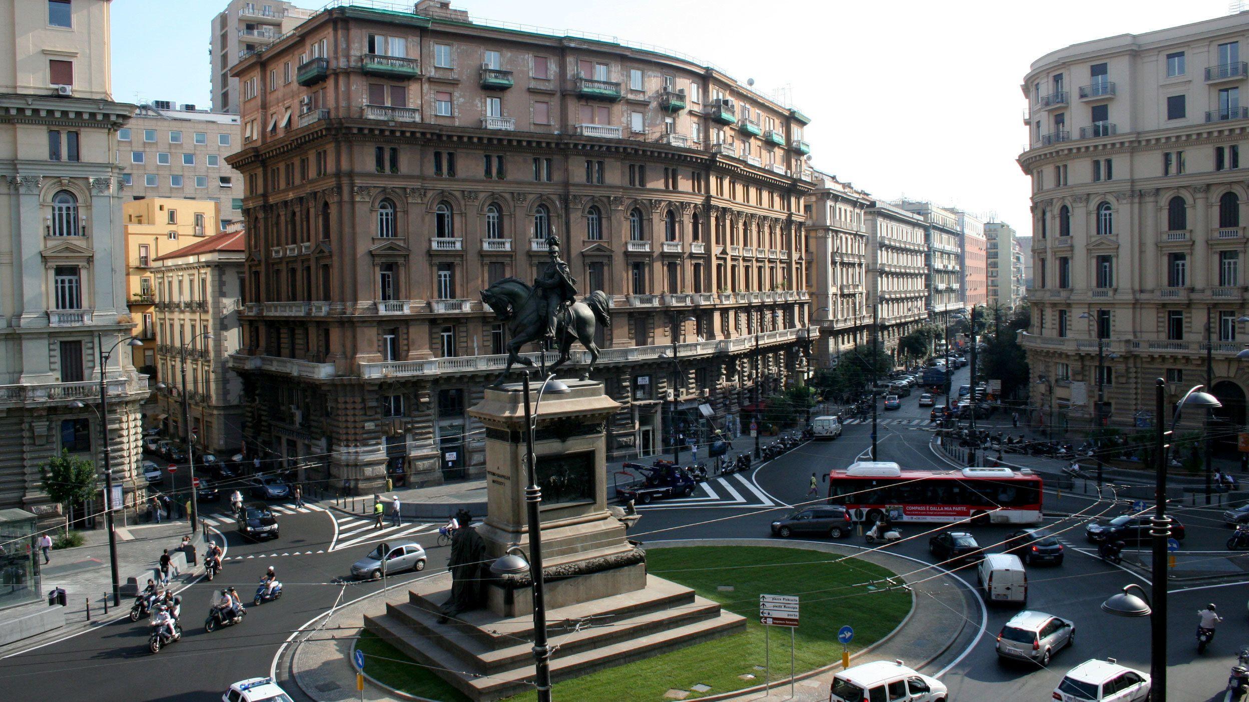 Piazza Giovanni Bovio and statue in the center of Naples