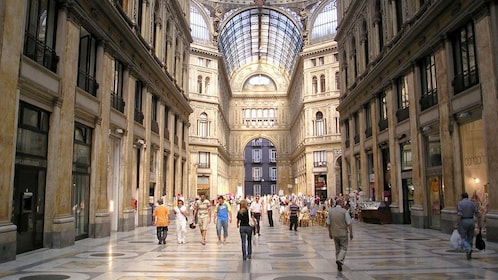 Interior of the Galleria Umberto I shopping center with people in Naples