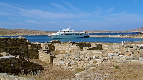 Tour boat docked on Delos Island