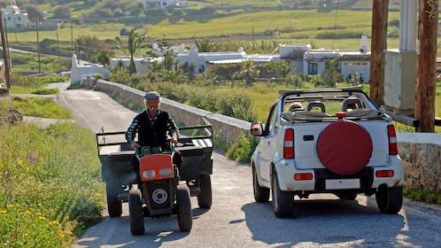 Jeep on a narrow road through fields and farmland on Mykonos