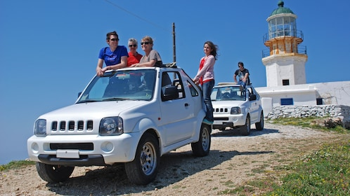 Jeep riding group stopping at a lighthouse on Mykonos