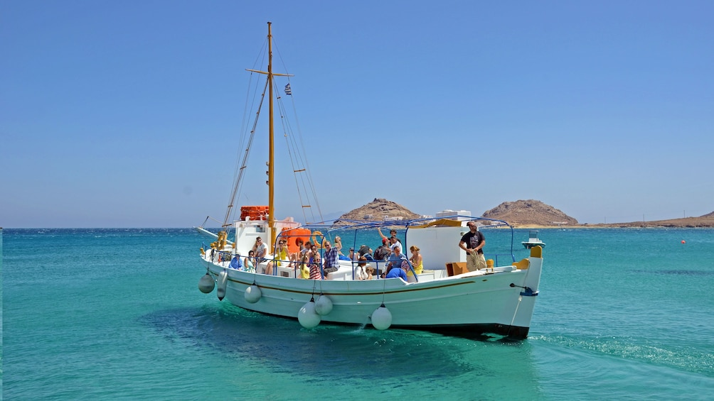 Sailboat with group on the water off the coast of Mykonos