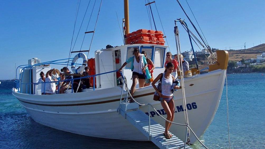 Tour group disembarking a sailboat on Mykonos