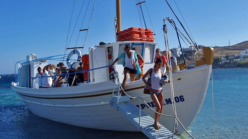 Tour group disembarking a sailboat on Mykonos