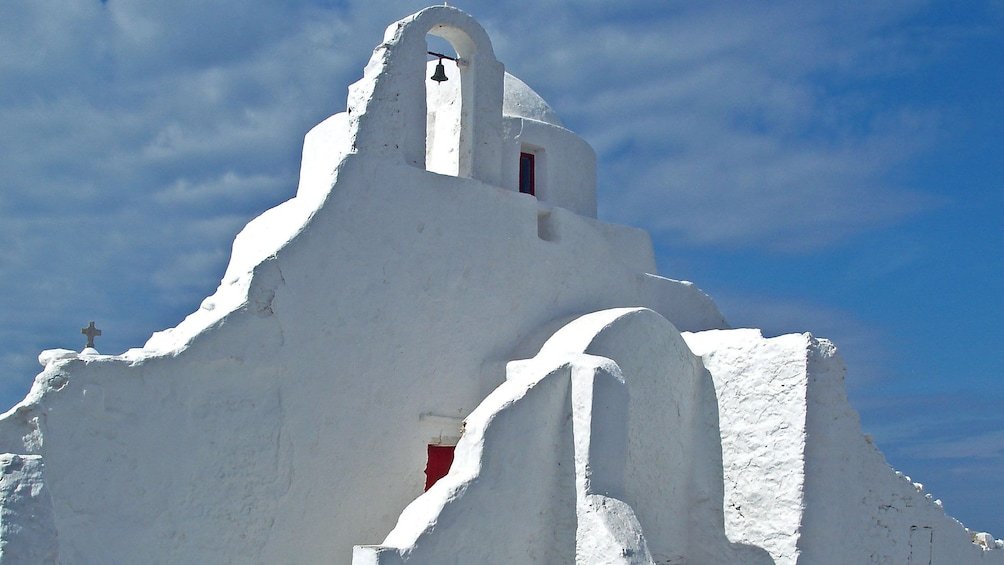 Show item 3 of 9. Whitewashed structure of the Church of Panagia Paraportiani in Mykonos