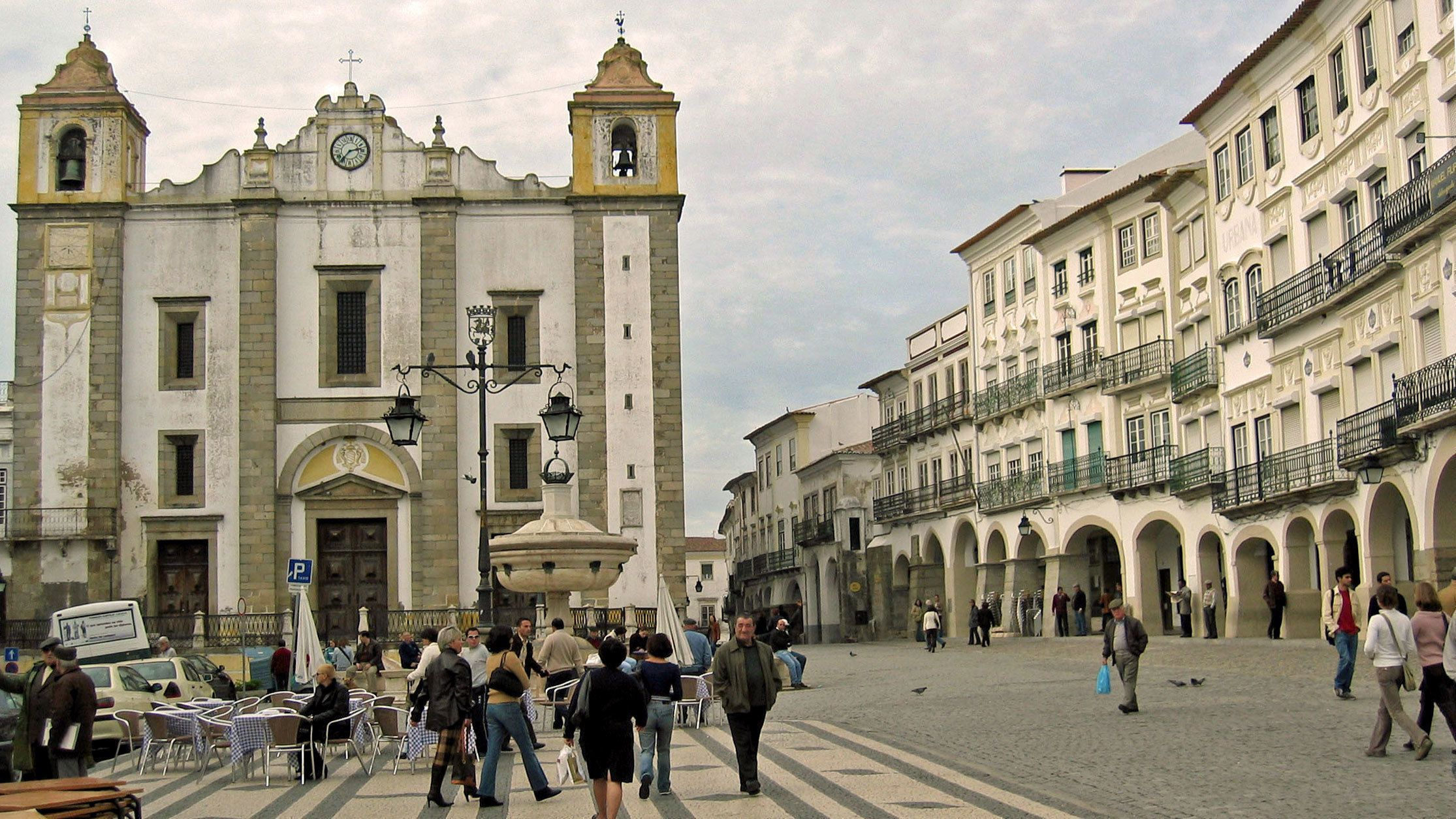 People walking through Giraldo Square in Evora
