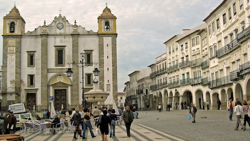 People walking through Giraldo Square in Evora