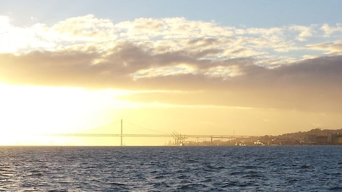 Seascape and bridge at sunset in Lisbon