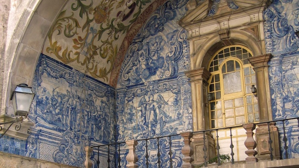 Show item 3 of 5. Blue mural on the main gate of the walled city of Obidos