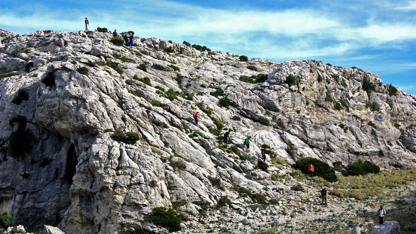 Scattered group along steep rocky terrains in Mallorca