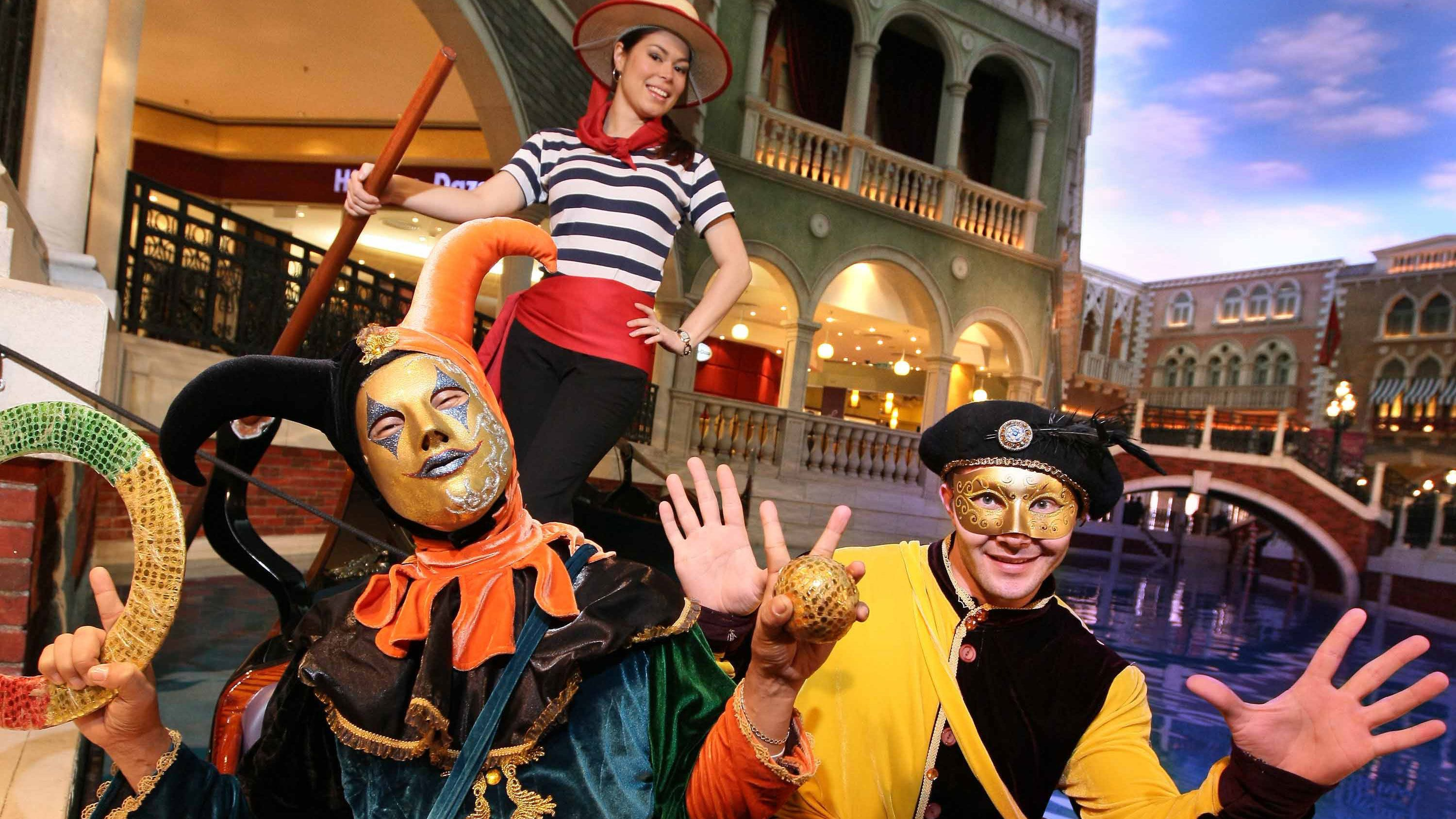 Female Gondolier and court jesters miming with hand gestures.