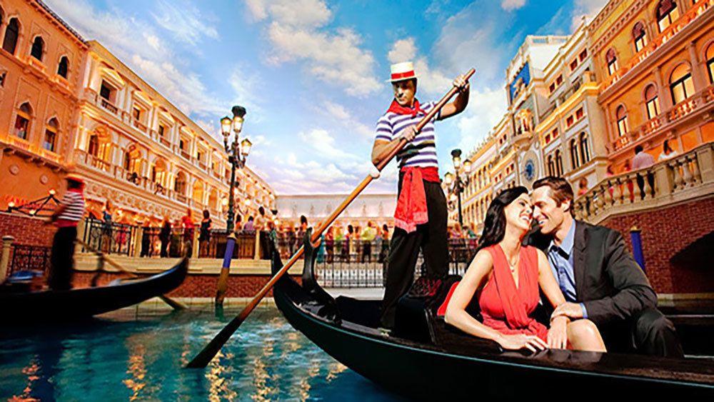 Happy couple enjoying gondola ride in Tuscany themed atmosphere.